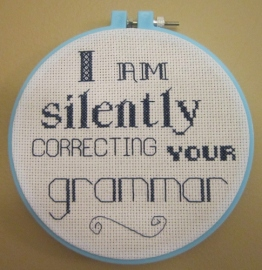 I am silently correcting your grammar cross-stitch sampler